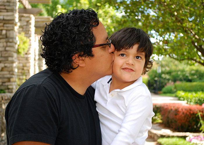 bigstock-Hispanic-father-kissing-his-ad-8203140